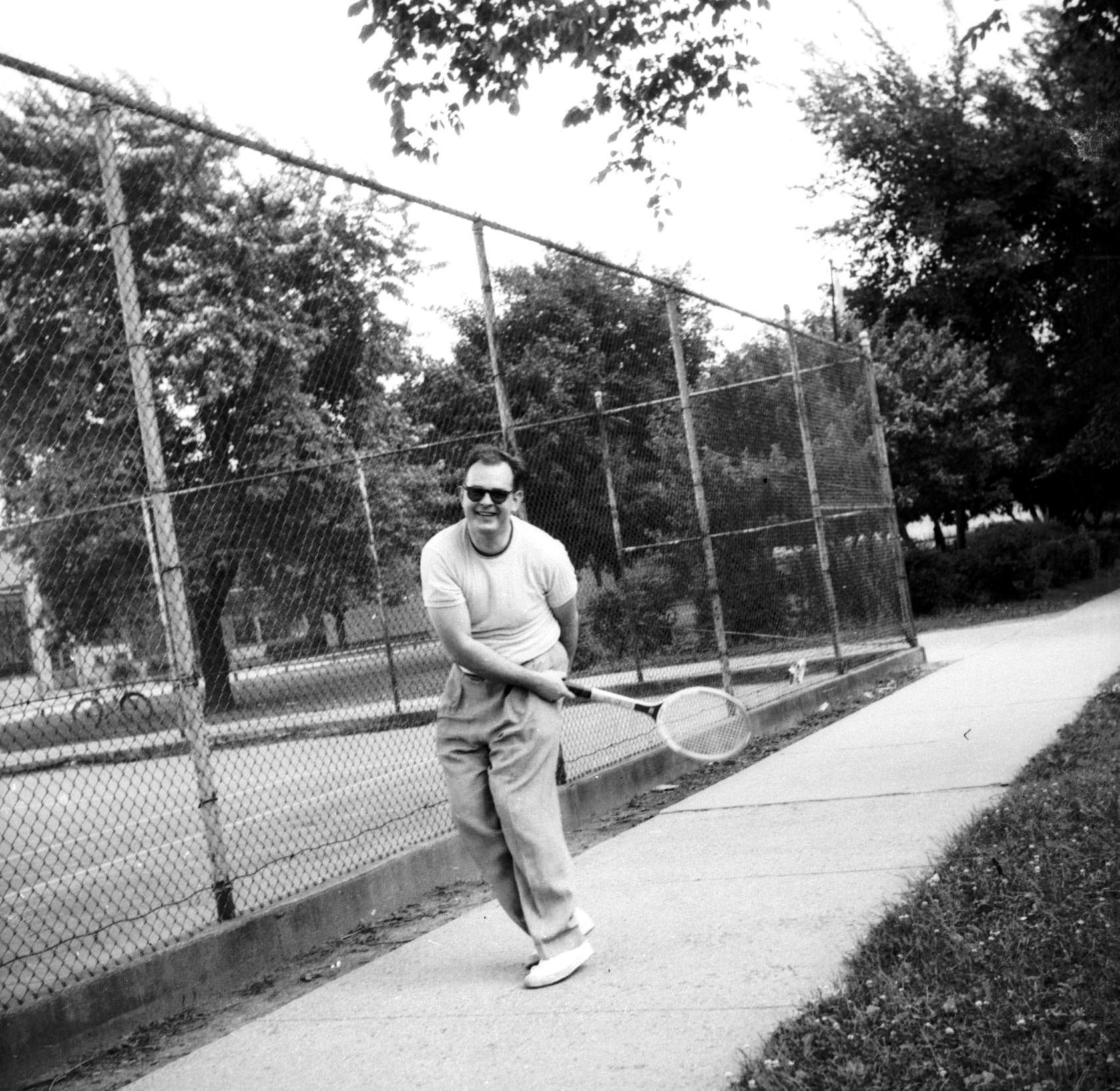 dad tennis note he is outside the court 1